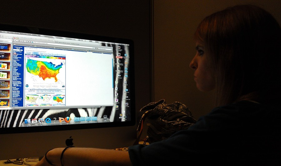 Darcy editing her weather slides.